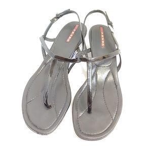 Prada T strap black patent leather sandals